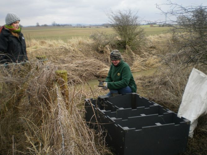 Installing the recycled plastic otter holt at North Farm on a cold day!